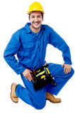 Seated construction worker posing with a smile Stock Images