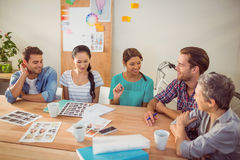 Seated creative business team working together Stock Image