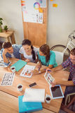 Seated creative business team working together Royalty Free Stock Photos