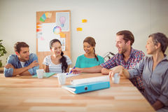 Seated creative business team working together Royalty Free Stock Images