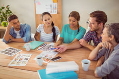 Seated creative business team working together Stock Photography