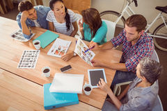 Seated creative business team working together Stock Photos