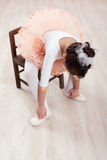 Seated Dancer Adjusting Her Shoes Royalty Free Stock Images