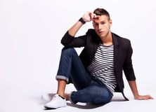 Seated fashion male model Stock Images