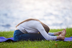 Seated Forward Bend yoga pose Stock Image