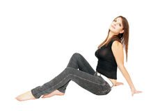 Seated girl. Girl sitting on the floor with his legs outstretched Royalty Free Stock Photography