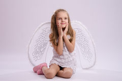 Seated girl with angel wings Royalty Free Stock Photography