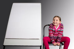 Seated Girl with Message Board Royalty Free Stock Photos