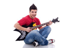 Seated guitarist playing Stock Images
