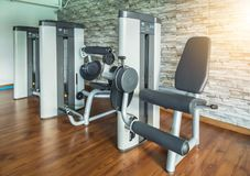 Seated leg press and health exercise equipment for bodybuilding. In modern fitness center gym room stock photos