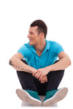 Seated man looking to side Royalty Free Stock Photo