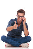 Seated man on the phone ok sign Stock Photos