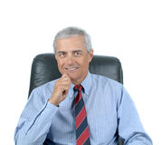 Seated Middle aged Businessman hand on chin Royalty Free Stock Photography