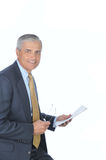 Seated Middle aged Businessman with Newspaper Royalty Free Stock Photo