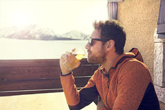 Seated and relaxed man drinking a beer in peace Stock Photography