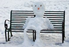 Seated snowman Royalty Free Stock Photos