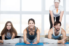 Seated straddle pose with coach Stock Photo