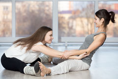 Seated straddle pose with partner Stock Image