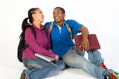 Seated Students Laugh at Each Other- Horizontal royalty free stock image
