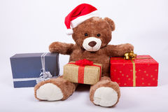 Seated teddy bear wearing a santa hat Stock Photography