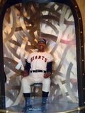 Seated Willie Mays Wax Statue on Display. SAN FRANCISCO - OCTOBER 11: Seated Willie Mays Wax Statue on Display at entrance to Wax Museum.  Willie Mays was one of Royalty Free Stock Photo