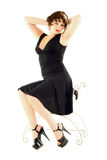 Seated Woman. A pretty woman seated on a stool Stock Photo