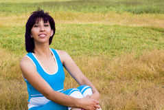 Seated  woman outdoors. Seated woman resting in nature after exercising Royalty Free Stock Photos