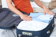 Seated woman packing stock photo