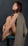 Seated Woman With Sweater Draped Over Shoulders Stock Images