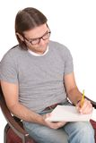 Seated writer Royalty Free Stock Photos