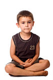 Seated young boy thinking Stock Photos