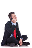 Seated young business man talking on the phone Royalty Free Stock Image