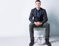 Seated Young Businessman with Alarm Clock Royalty Free Stock Photography