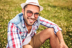 Seated young casual man laughing for the camera Stock Photo