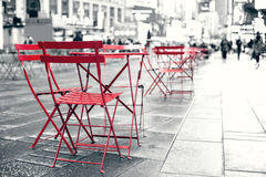 Seating area at plaza in busy Times Square NYC Royalty Free Stock Images