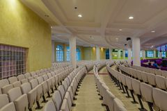 Seating arrangement on the ground floor of the new Auditorium of Deeper Life Bible Church Gbagada Lagos Nigeria. Seating arrangement of the new Auditorium of royalty free stock photography