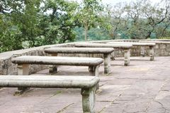Stone slab benches outside the Chausat Yogini temple at Jabalpur, India. Seating arrangement outside the Chausat Yogini temple at Jabalpur, India stock photography