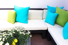 Seating with cushions. Seating and cushions with fresh plants royalty free stock image