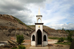 Seating Only 6. Designed as a place of whorship, the Little Church in Drumheller is a tourist attraction. It is said on monument sign that it sits 10,000 people Stock Photo
