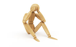 Seating figure - worries over the head. Seating figure with its head in hands.  Wooden model pieces on white background Royalty Free Stock Images