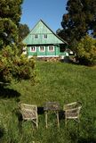 Seating in front of cottage Stock Photos