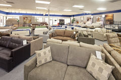 Seating furniture and mattress displayed in store Stock Photography