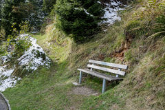 Seating in Gimmelwald with Snow in Autumn Switzerland. Seating in Gimmelwald with Snow and green yellow grass in Switzerland Autumn Royalty Free Stock Photography