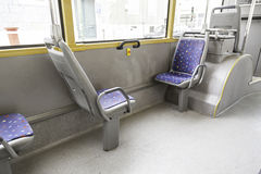 Seating inside a tram Stock Photo