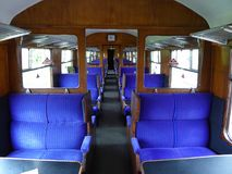 Seating layout in a historical train carriage. The interior seating arrangement in a restored passenger carriage on a heritage train line in England Royalty Free Stock Image