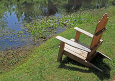 Seating by the Pond royalty free stock photography