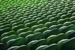 Seating rows in a stadium with weathered chairs Stock Image