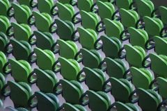 Seating rows in a stadium with weathered chairs Royalty Free Stock Photos
