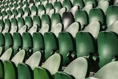 Seating rows in a stadium with weathered chairs Stock Photography