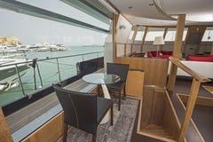 Seating in salon area of luxury motor yacht Stock Image